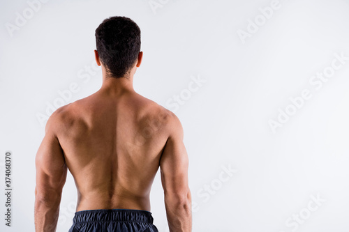 Foto Rear back behind view of his he nice attractive content sportive tanned brunet g
