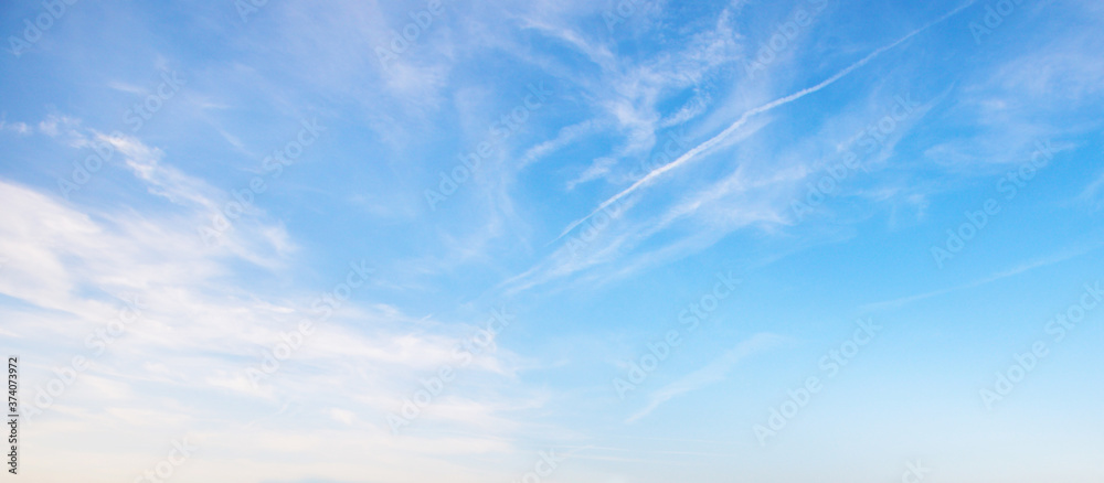 Fototapeta View of the blue sky with white clouds. Heavenly beauty. For wallpapers, backdrops and covers.