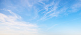 Fototapeta Na sufit - View of the blue sky with white clouds. Heavenly beauty. For wallpapers, backdrops and covers.