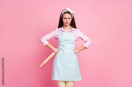 Portrait of frowning aggressive mother wife hold rolling pin put hands waist wan Wallpaper Mural