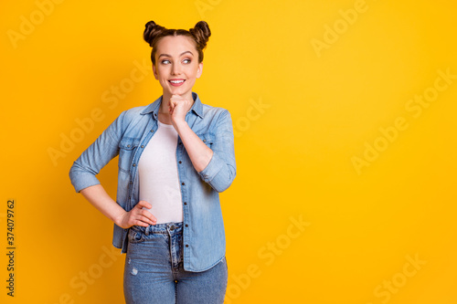 Fotografering Photo of attractive pretty teen lady two buns hairdo hold smart student college
