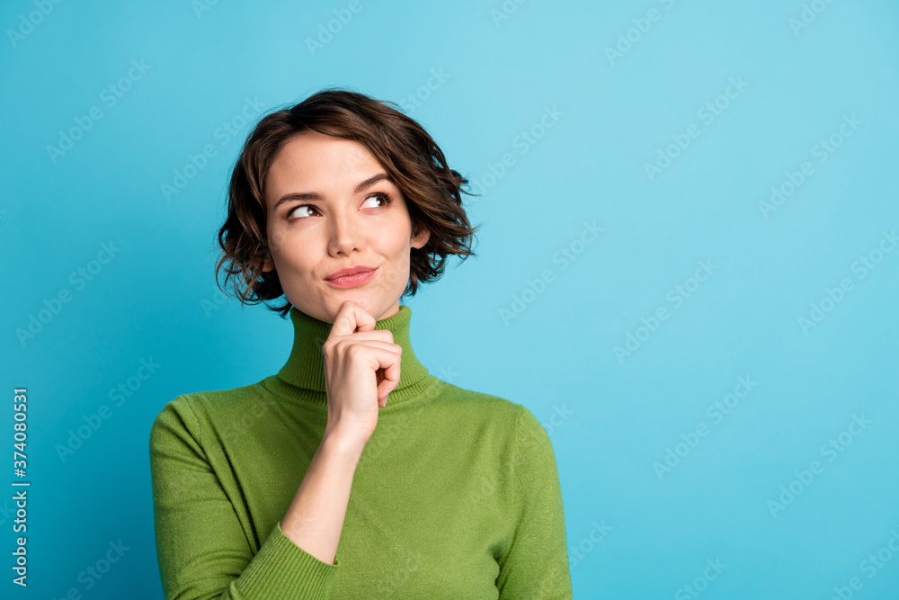 Fototapeta Portrait of minded woman touch hand chin look copyspace think thoughts plan autumn holiday wear jumper isolated over blue color background