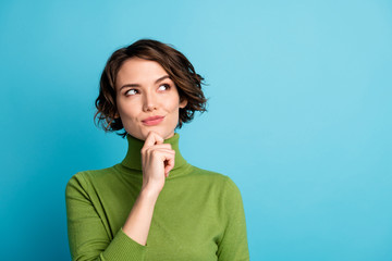 Portrait of minded woman touch hand chin look copyspace think thoughts plan autumn holiday wear jumper isolated over blue color background