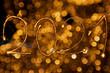 canvas print picture - weihnachtliches Motiv mit Lichtpunkten und Lichtbuchstaben schreiben 2021 für das neue Jahr in warmen Farben.