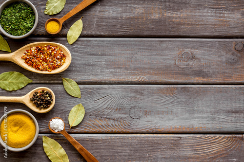 Fototapeta Colourful herbs spices and flavoring for cooking