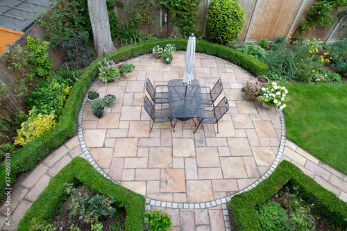 circular garden patio with freshly jet washed paving stones Canvas Print