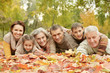 canvas print picture Happy smiling family relaxing in autumn park