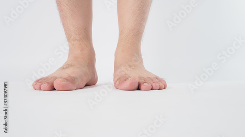 Photographie Male leg is isolated on white background
