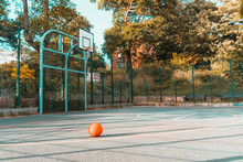 Basketball On An Empty Court At A Park