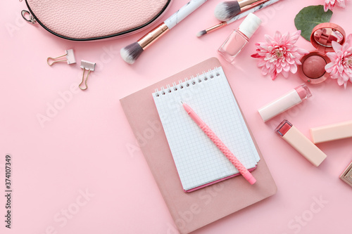 Different stationery with makeup cosmetics on color background Fototapet