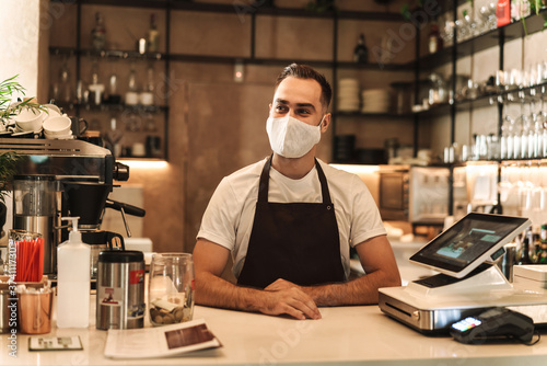 Fototapety, obrazy: Barista with face mask in coffee shop, lockdown, quarantine, coronavirus, back to normal concept