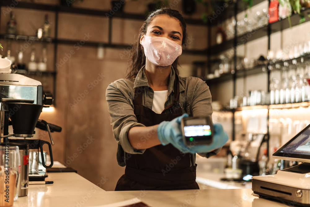 Woman barista wearing medical face mask