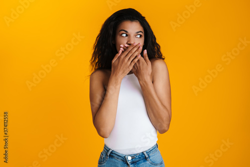 Fotografie, Tablou Surprised shocked young african woman