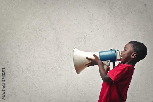 Fototapeta .portrait of child yelling into a megaphone