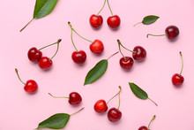Ripe Sweet Cherry On Color Bac...