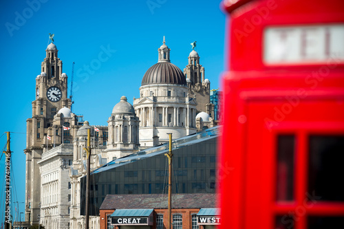 Fotografiet View of Liverpool's iconic grand old waterfront buildings with a classic red bri