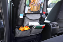 Travel Organizer With Different Things On Car Seat In Salon