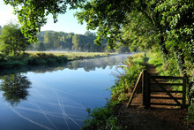 Early Morning Mist Over The Meadows On The River Wey In Godalming, Surrey, On A Cold Autumn Morning.