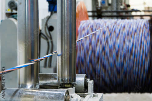 Photo A coil of power electric cable in insulation on a metal coil