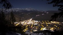 Time Lapse Showing The Town Of Jackson Wyoming Nightlife From High Above The Town. Grand Teton Mountains In The Distance While Stars Rotate Around The Night Lapse.