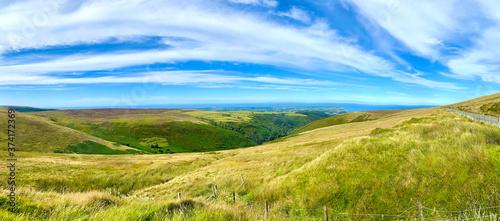 Fotografie, Obraz Looking towards the coastal town of Ramsey from the famous Isle of Man TT Mounta