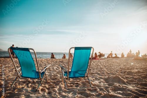 Fotografie, Obraz Closeup shot of loungers on the beach