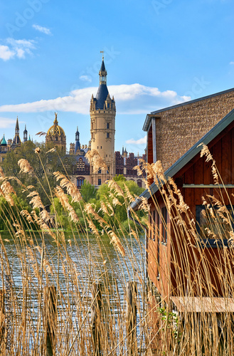 Reeds and wooden boathouse on Lake Schwerin with castle in the background Canvas Print