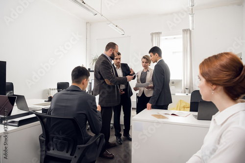 The chief of the construction company holds a standing meeting with subordinates Canvas Print