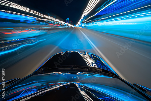 Photo View from roof of a Black Car moving in a night city, Blured road with lights with car on high speed