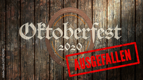 Photo German message OKTOBERFEST 2020 - CANCELLED on wooden background