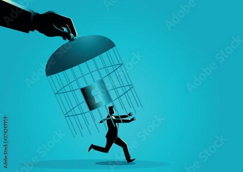 Fotografie, Obraz Giant hand capturing a running businessman with birdcage