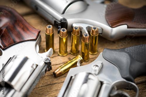 Ammunition  and Revolver guns on wooden background Fototapet