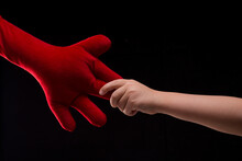 Cute Little Boy Hand Holding Big Red Soft Toy Hand. Young Boy And His Imaginary Friend, Comforting Toy