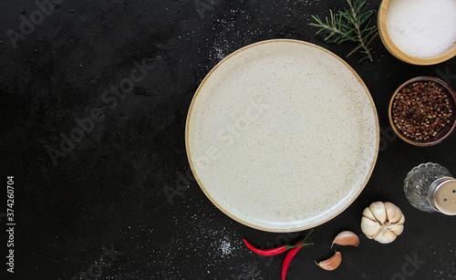 Fotografie, Obraz Empty white plate on a dark metal background