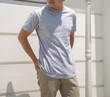 Young handsome man wearing heather grey t shirt short sleeve was posing at outdoor