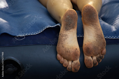 dirty cracked feet of a girl who lies on a mattress in the forest Slika na platnu