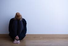 Sad Teenager Girl Sitting Curl...