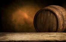 Wooden Barrel On A Table And T...