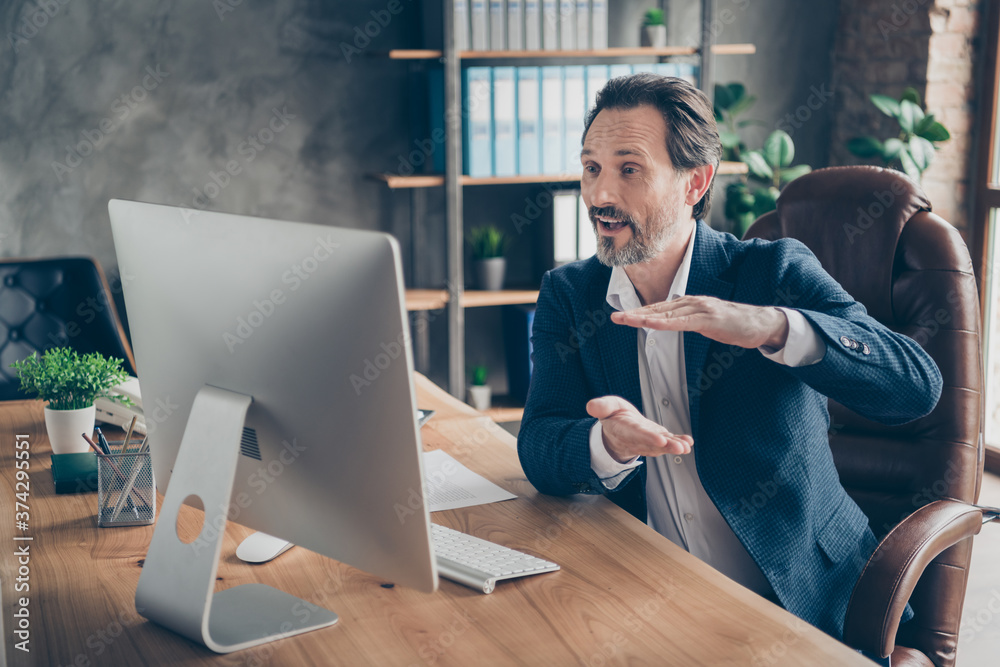 Fototapeta Profile side view portrait of his he nice handsome cheerful man ceo boss chief shark expert specialist attending web meeting discussing strategy at modern loft concrete industrial work place station - obraz na płótnie