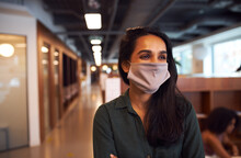 Portrait Of Indian Businesswoman Wearing Face Mask In Office