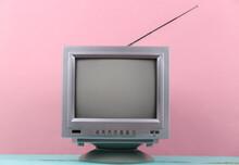 Retro Old Tv Set On Pink Background.
