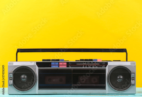 80s Retro outdated portable stereo radio cassette Recorder on yellow background Canvas Print
