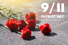 Carnations On The Memorial With The American Flag. Patriots ' Day. September 11. We Will Never Forget