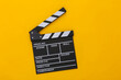 Movie clapper board on yellow background. Filmmaking, Movie production, Entertainment industry. Top view