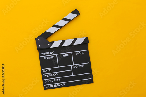 Canvas Print Movie clapper board on yellow background