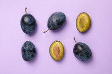 Flat Lay With Plums On Violet ...