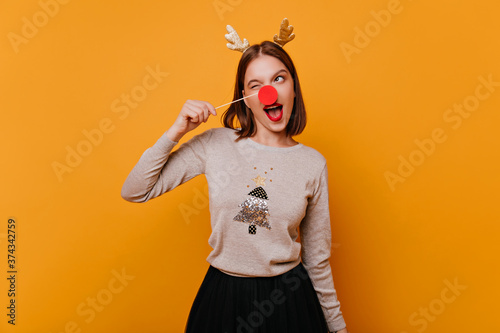 girl 25 years old, in her pullover with a New Year's print cute makes an amusing Canvas Print