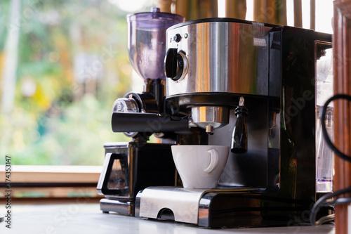 Fototapeta white coffee cup and coffee maker machine