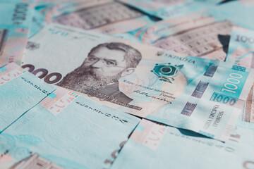 Obraz na płótnie Canvas Ukrainian hryvnia in the face value of one thousand hryvnias, texture of one thousand hryvnia banknotes close-up.
