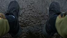 A Man's Feet In Black Shoes Da...
